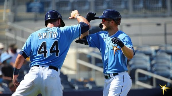 Austin meadows gets congratulated by Kevan Smith after a home run