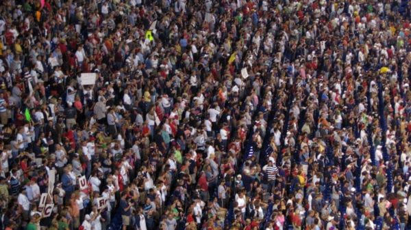 A crowd of people in their seats enjoying a baseball game. Stock photo