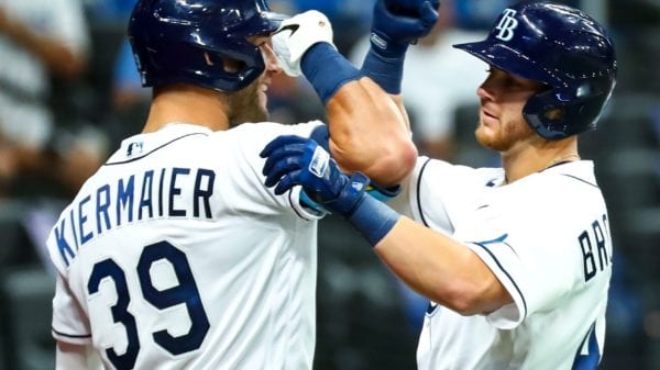Rays third baseman Mike Brosseau celebrates with Kevin Kiermaier after his home run