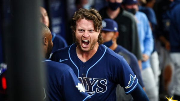 Rays outfielder Brett Phillips after scoring from second base on a pair of errors