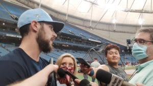 Rays first baseman Ji-Man Choi joins the media contingency interviewing reliever Ryan Thompson